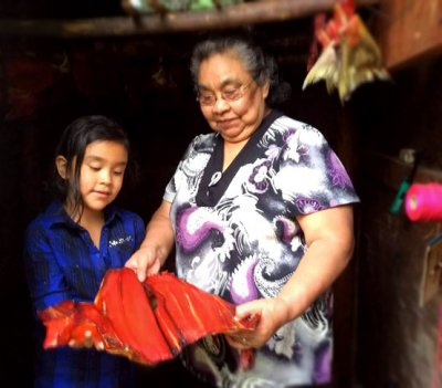 Verna Inkster and grandaughter Kitsumkalum smoking fish